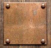 Metal plate on wooden background