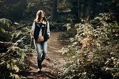 Happy Hipster Traveling And Smiling, Walking In Woods In Light. Wanderlust And Travel Concept With S poster