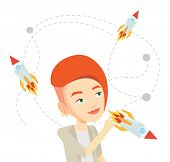 Caucasian woman looking at flying business rockets. Young woman came up with an idea for a business  poster
