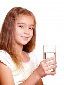 Beauty girl with a glass of clear water - over white background