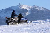 Man on snowmobile in the Sumava National Park - Czech Republic Europe