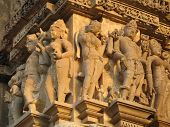 foto of kamasutra  - Sculptures on the Temples in Khajuraho India illustrating Kamasutra - JPG