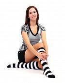 stock photo of knee-high socks  - Sexy girl in funny socks posing on her knees - JPG
