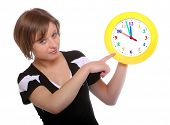 Beautiful blonde holding funny clock. Conceptual image. Great for tourist trade brochure and adverti