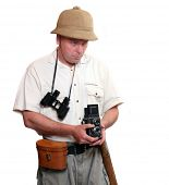 Photographer with vintage TLR camera dressed on suit for tropical destination. Studio shot isolated on white background.