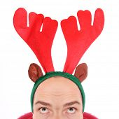 Crazy man with reindeer attire - head closeup. Funny image great for christmas and new year greeting