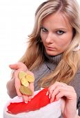 Beautiful young woman with golden coins.