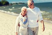 family, age, travel, tourism and people concept - happy senior couple hugging on summer beach poster