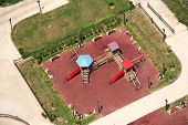 image of swingset  - an elevated view of slides and swings in the park - JPG