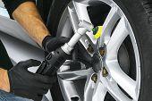 Car Polish Wax Worker Hands Polishing Car Wheel. Buffing And Polishing Car Disk. Car Detailing. Man  poster