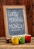 Good Morning Monday sign - white chalk handwriting on a blackboard with cups of espresso coffee agai poster