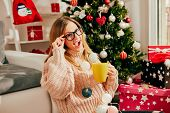 Portrait Of Beautiful Woman Drinking Coffee And Enjoying With Christmas Presents Near Christmas Tree poster