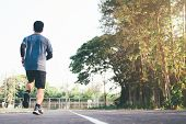 Runner Man. Health And Fitness Outdoor Concept. Man Is Jogging In The Morning. Young Man Doing Sport poster