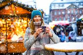 Beautiful Young Woman Drinking Hot Punch, Mulled Wine On German Christmas Market. Happy Girl In Wint poster