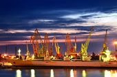 stock photo of container ship  - Port warehouse with cargoes and containers at night - JPG