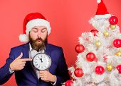 Man Bearded Wear Suit And Santa Hat Hold Clock. Last Minute Deals. Counting Time Till Christmas. How poster