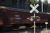 Railroad Crossing With Train In Motion