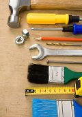 set of tools and instruments on wood board