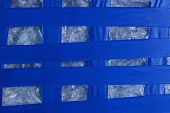 Plastic Striped Texture Of Blue Electrical Tape On White Cellophane poster