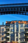 Metal Structure Of Footbridge And Facade Of Art Nouveau Tenement House In Poznan poster