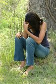 stock photo of mental_health  - Teen feeling sad rejected and depressed outdoors. ** Note: Slight blurriness, best at smaller sizes - JPG