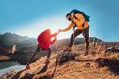 Helping Hand - Hiker Woman Getting Help On Hike Happy Overcoming Obstacle. poster