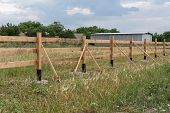 Ranch Style Fence. Rural Wooden Fence On Green Grass At Farm Ranch Land In Shagany, Ukraina. poster