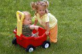 Boy and girl with wagon