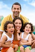 stock photo of family vacations  - happy family portrait outdoors during a holiday  - JPG