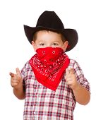 Child dressed up as cowboy playing isolated on white