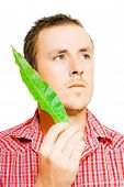 Handsome Man Holding A Green Leaf