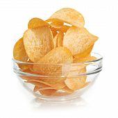 Delicious potato chips in bowl