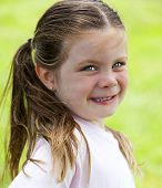 Little Girl In Grass At The Park