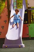 picture of chute  - Joy sliding down a chute for a small Hispanic girl - JPG