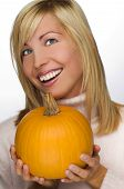 picture of beautiful face  - young blond woman holding orange pumpkin close up - JPG