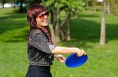 image of frisbee  - Young woman having fun with frisbee in the parkin sunny summer day - JPG