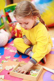 image of children playing  - Cute child playing with puzzle  - JPG