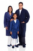 cute indian family wearing nightclothes isolated on white background