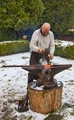 Blacksmith Working Outside In Winter