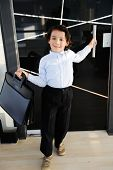 Little boy businessman at father's office