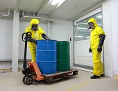 image of radioactive  - Workers in protective uniform - JPG