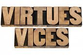 virtues and vices  - ethics concept -collage of isolated text in letterpress wood type