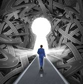 image of keyholes  - Direction solutions as a business leadership concept with a businessman walking to a glowing key hole shape opening as a straight path to success choosing the right strategic path cutting through a confused maze of tangled roads and highways - JPG