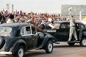 MOSCOW - AUG 25: Stuntmen depict a gunfight on old cars on Festival of art and film stunt Prometheus in Tushino on August 25, 2012 in Moscow, Russia. The festival was organized in 1998.