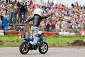 MOSCOW - AUG 25: Kid on motorcycle stunt shows on Festival of art and film stunt Prometheus in Tushi