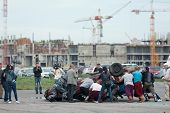 MOSCOW - AUG 25: Rescuers rushed to the overturned car on Festival of art and film stunt Prometheus