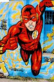 Street art mural of Flash supehero