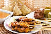 Chicken satay, ketupat or malay rice dumpling, lemang, rendang. Traditional Malay food, ramadan dish