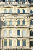 arched windows of building facade in Trafalgar Square, London