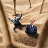 stock photo of quicksand  - Two businessmen fall into the quicksand trap - JPG